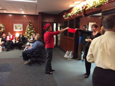 knox law staff participating in 2016 holiday charity auction