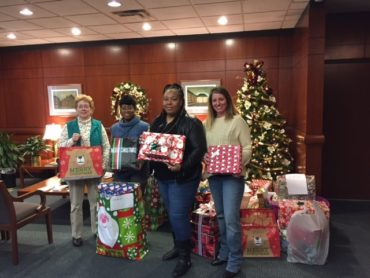 knox law staff and Safenet staff with donated gifts for SafeNet families holiday 2016