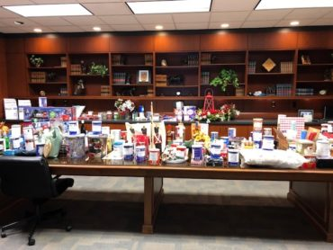 photo of our holiday auction items setup in conference room