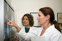 two health professionals reviewing xrays