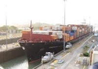 Photo of a large barge in the panama canal